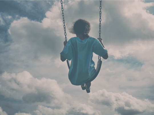 A child playing on a swing